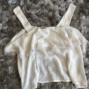 Cream colored frilled top